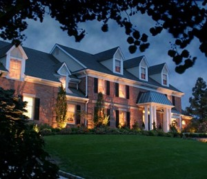 Gorgeous home with outdoor landscape lighting providing a curb appeal effect