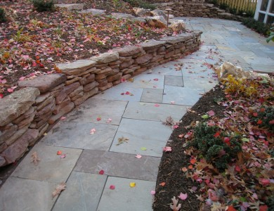 Flagstone walkway with fieldstone wall in North Arlington.