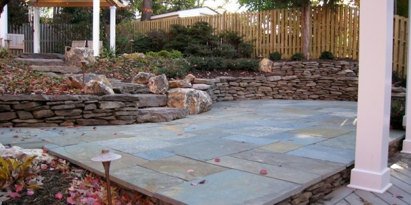 Flagstone patio with fieldstone retaining walls and steps in North Arlington.
