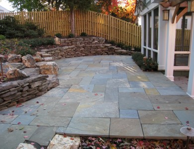 Flagstone patio with fieldstone retaining walls in North Arlington.