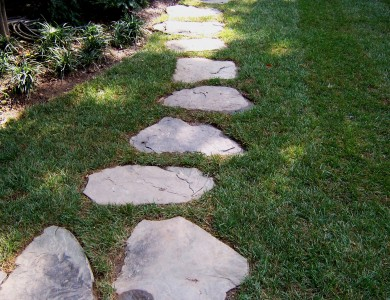 Fieldstone steppers set in grass in North Arlington.