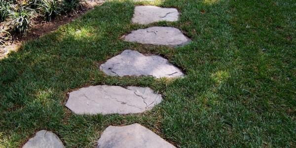 Fieldstone steppers set in grass in North Arlington.