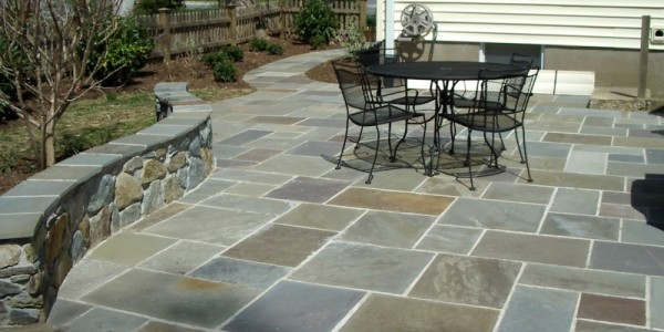 Flagstone patio with building stone seating wall in Falls Church.