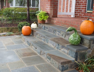 Flagstone landing with building stone steps in North Arlington.