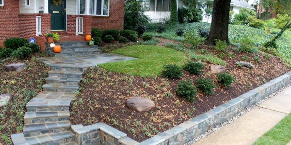 Flagstone landings and steps with building stone retaining walls and risers in North Arlington.