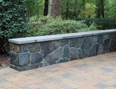 Seating wall with flagstone top and paver patio in North Arlington.