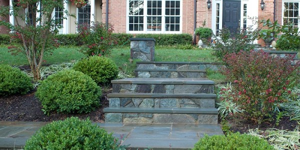 Flagstone landings and steps with building stone columns and risers in Vienna.