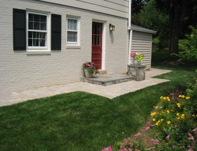 Flagstone landing with building stone column and paver walkway in McLean.