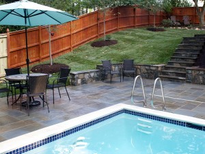 Flagstone patio with stone seating wall and stone
