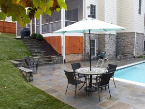 Flagstone patio with stone seating wall and stone steps, North Arlington, VA