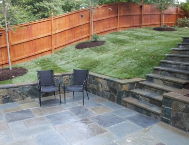 Flagstone patio with building stone steps and retaining wall in North Arlington.