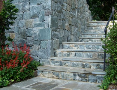 Flagstone steps and landing with building stone wall in Vienna.