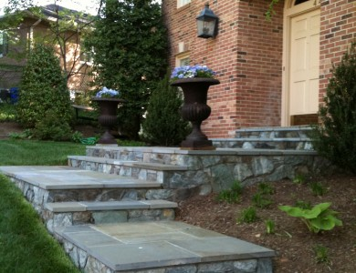 Flagstone landing and steps with building stone risers in North Arlington.