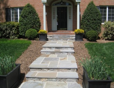 Flagstone landing and steps with building stone risers in McLean.