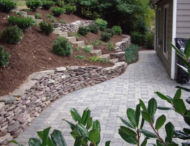 Fieldstone retaining wall and paver patio in McLean.