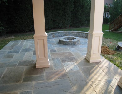 Flagstone patio with building stone seating wall and fire pit in McLean.