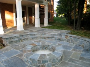 Flagstone patio with building stone seating wall and fire pit in McLean, VA