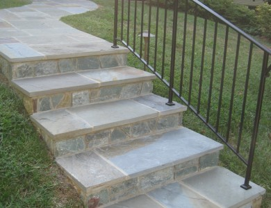 Flagstone walkway and steps with building stone risers in McLean.