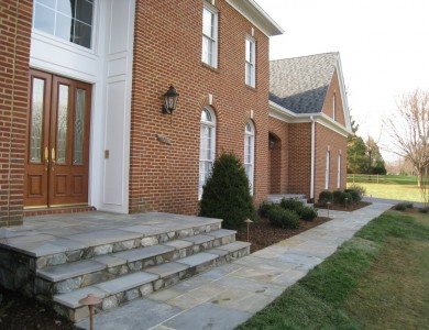 Flagstone steps and walkway with building stone risers in Great Falls.