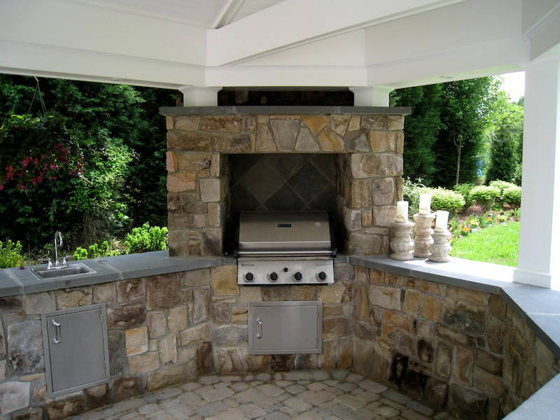built in grill and outdoor kitchen made with building stone in falls