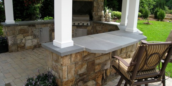 Built-in grill and outdoor kitchen made with building and flagstone in Falls Church.