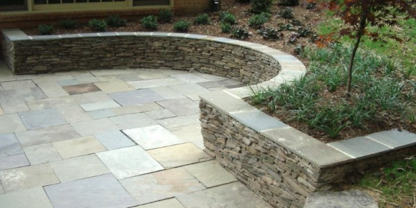 Flagstone patio with fieldstone seating wall in North Arlington.
