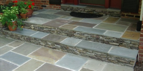 Flagstone landing and steps with fieldstone riser in McLean.