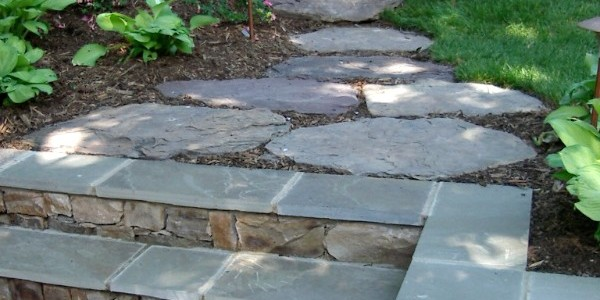 Flagstone steps with building stone wall and fieldstone steppers in Falls Church.