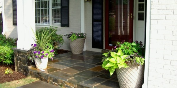 Flagstone landing with building stone risers and column in McLean.