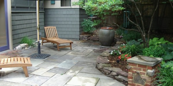Flagstone patio with fieldstone wall and brick column in North Arlington.