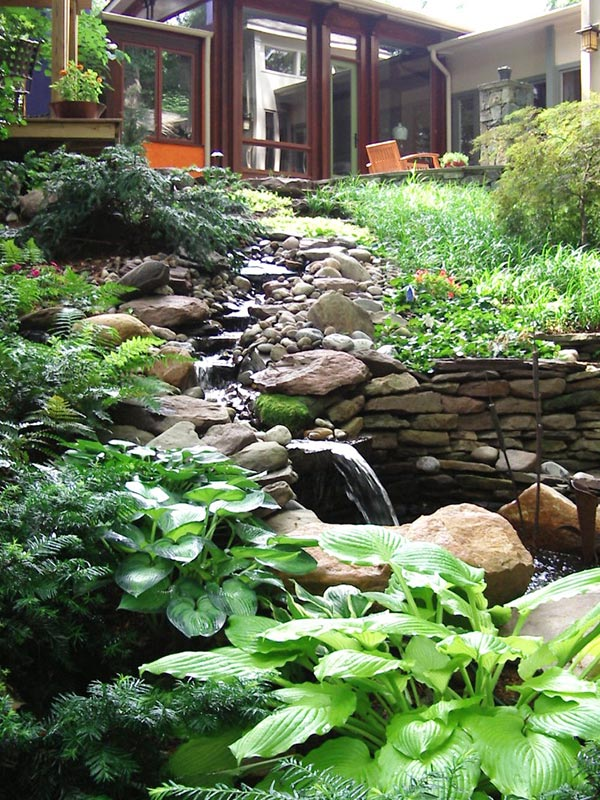 Stream running from floating deck and patio area in North Arlington.