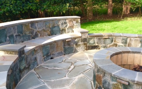 Flagstone Patio with built-in seating and fire pit located in McLean, VA