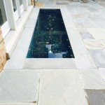 McLean, VA Flagstone patio with sprinkler water feature and lighting