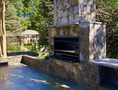 Outdoor Stone Fireplace with a Braai Grill, Counter Top, and Patio – Outdoor Living Design and Installation in Vienna, VA