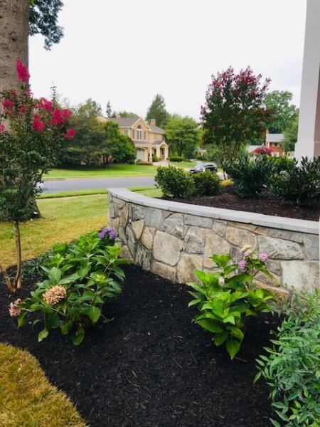 Flagstone wall with mulch bed